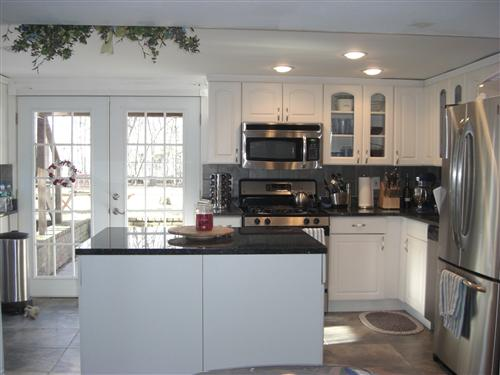 Anyone have white cabinets if so for White kitchen cabinets with blue pearl granite
