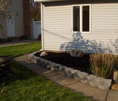 Raised Bed Retaining Wall: Our New Retaining Wall
