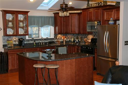 have Blue Pearl We love it We have Cherry Wood Cabinets with a